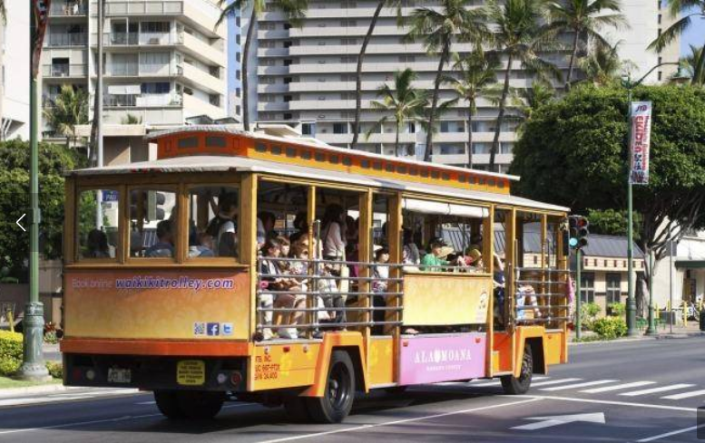 Riding the Ala Moana Shopping Centre Trolley down Kalakaua Avenue in Waikiki. Photo: iStock
